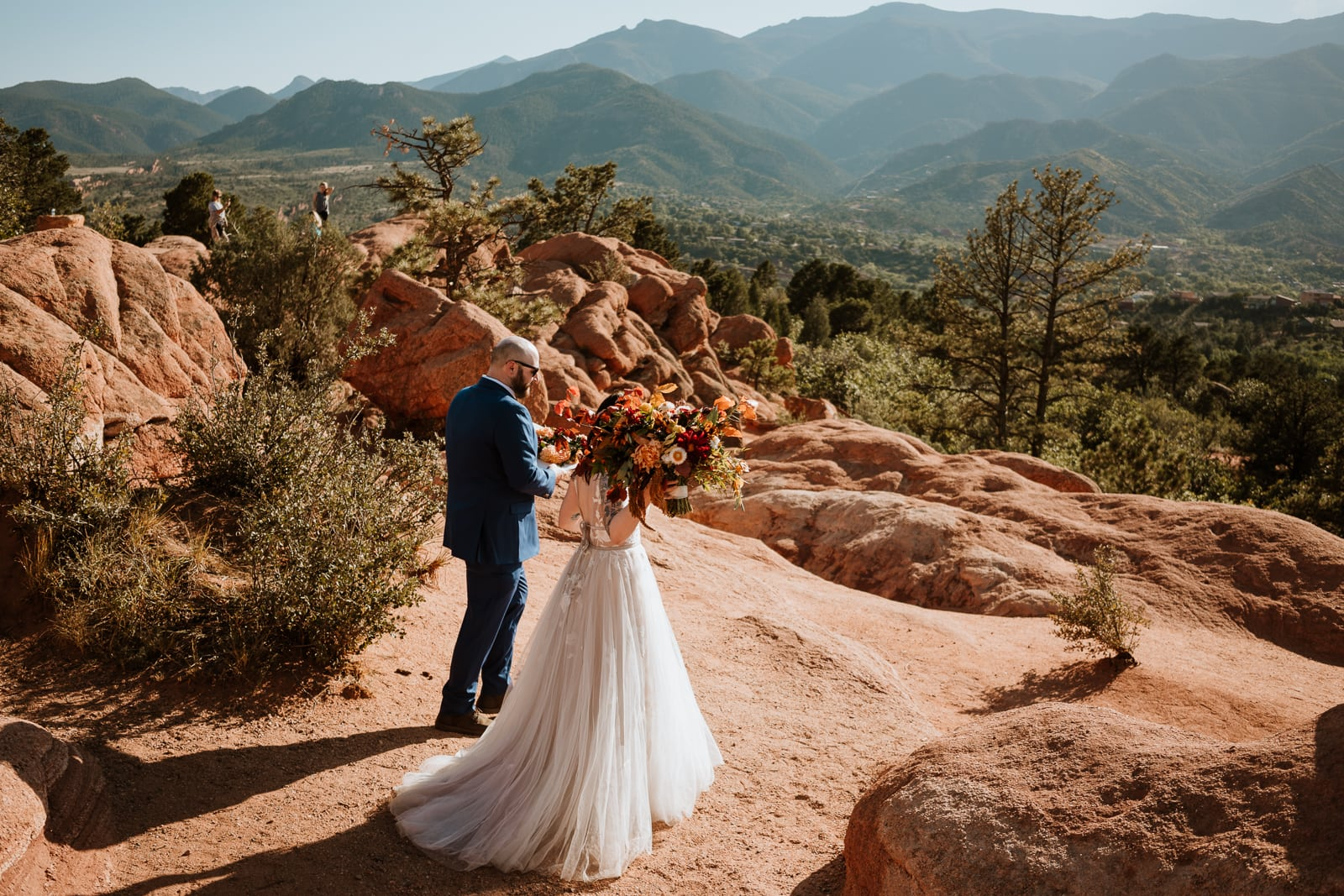 Bride and groom walking to their elopement ceremony location at High Point in Garden of the Gods Colorado